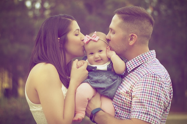 loving-couple-with-happy-baby